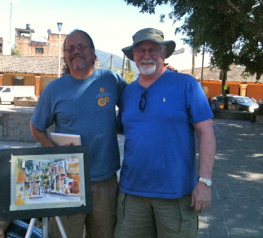 Bob Masla and Sterling Edwards at the zocalo in the mountain town of El Tuito displaying the plein air demo that Sterling had just completed